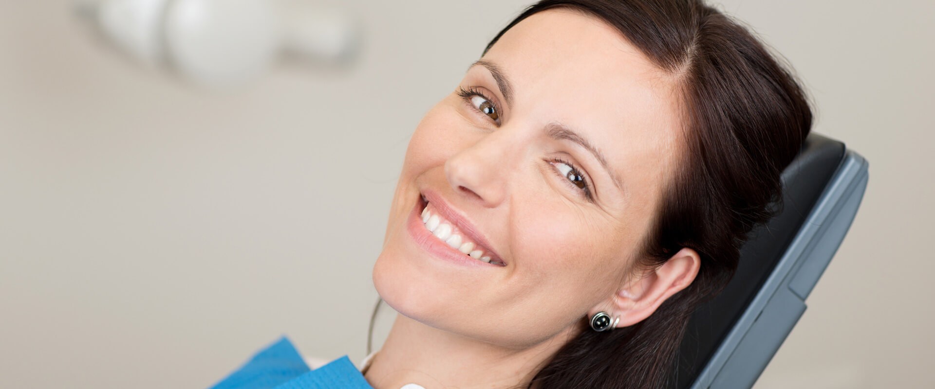 Smiling woman seated ready for emergency care