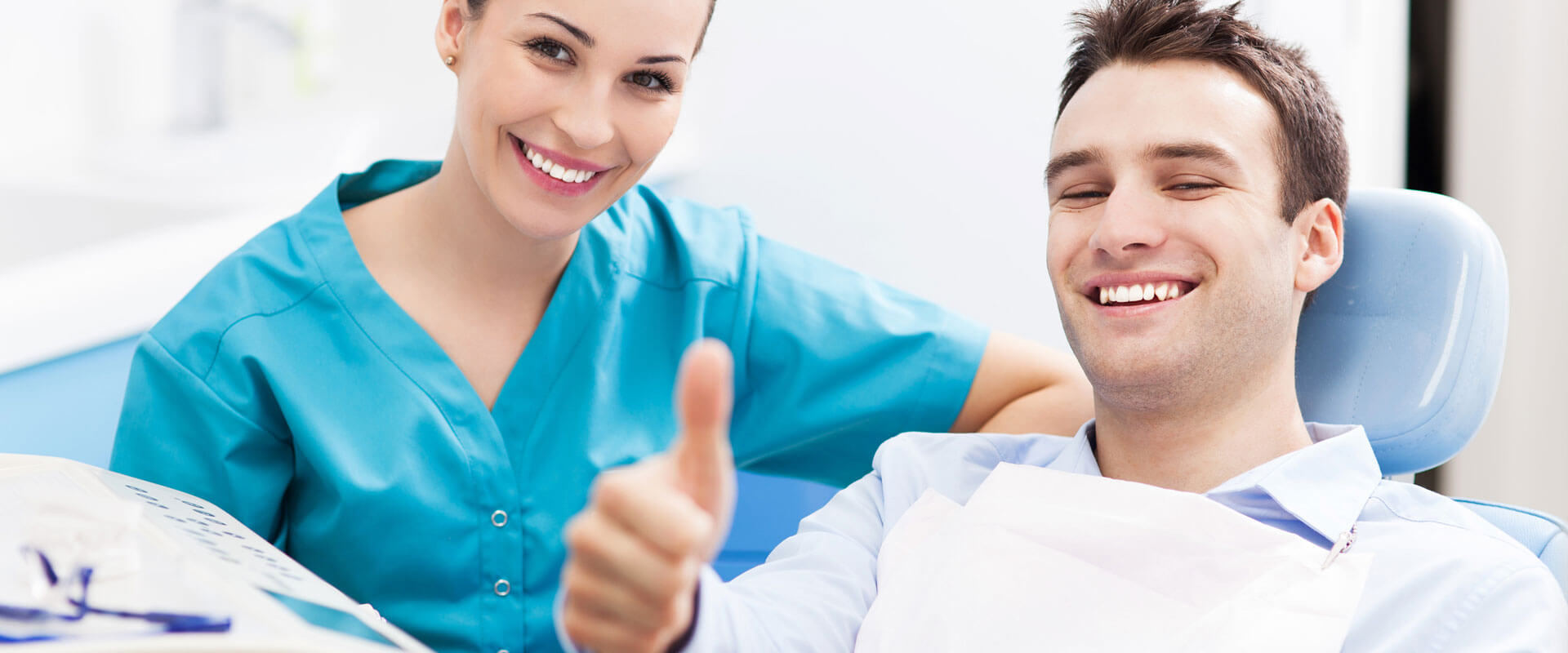 Man giving thumbs up ready for oral surgery