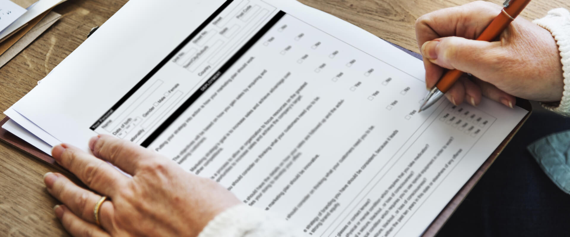 Patient filling medical forms