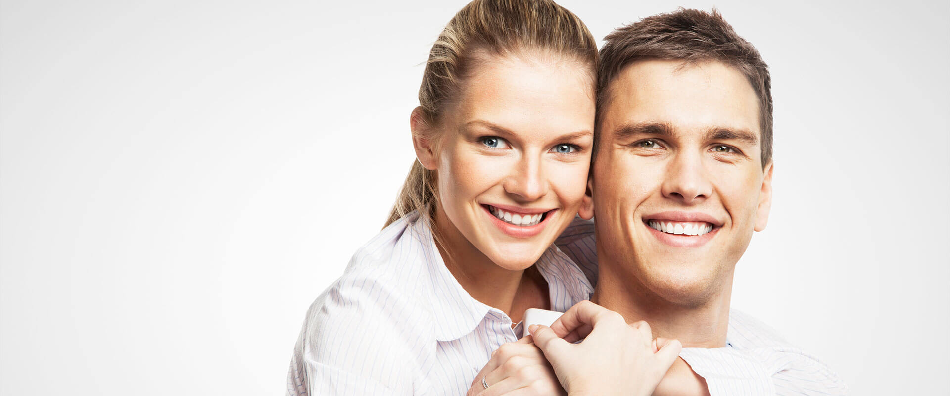 Happy young couple embracing each other after preventive care treatment