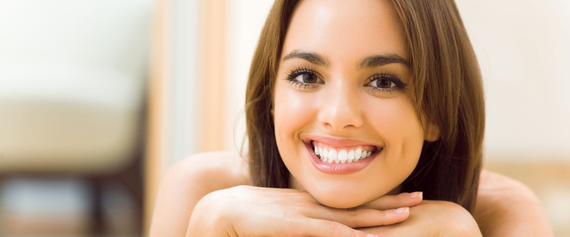 Beautiful showing off her bright white smile after teeth whitening